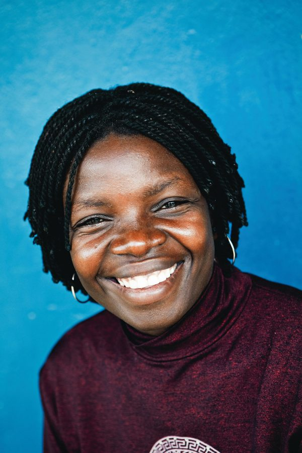 colourful-headshot-portrait-photography-malawi-smiling-woman-blue