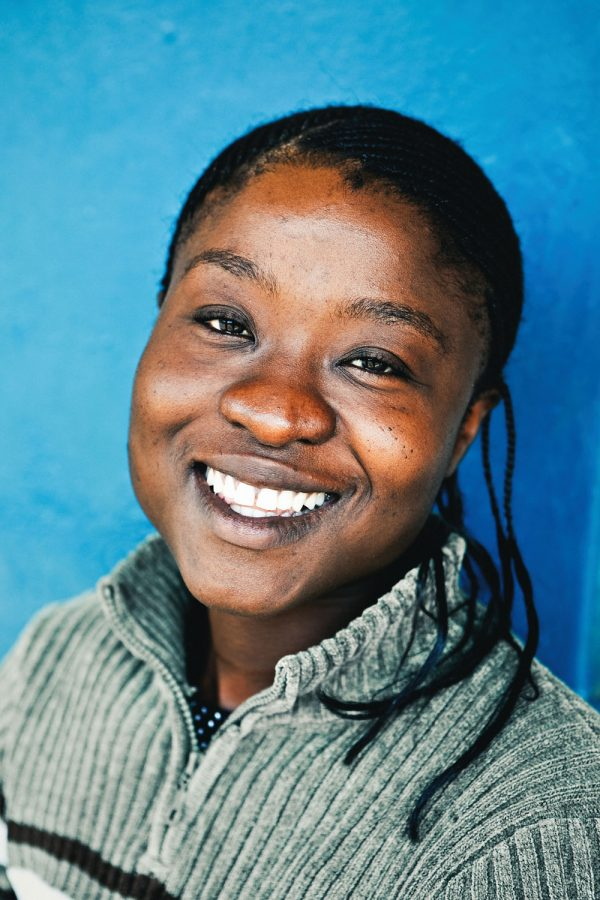 colourful-headshot-portrait-photography-malawi-woman-happy-blue