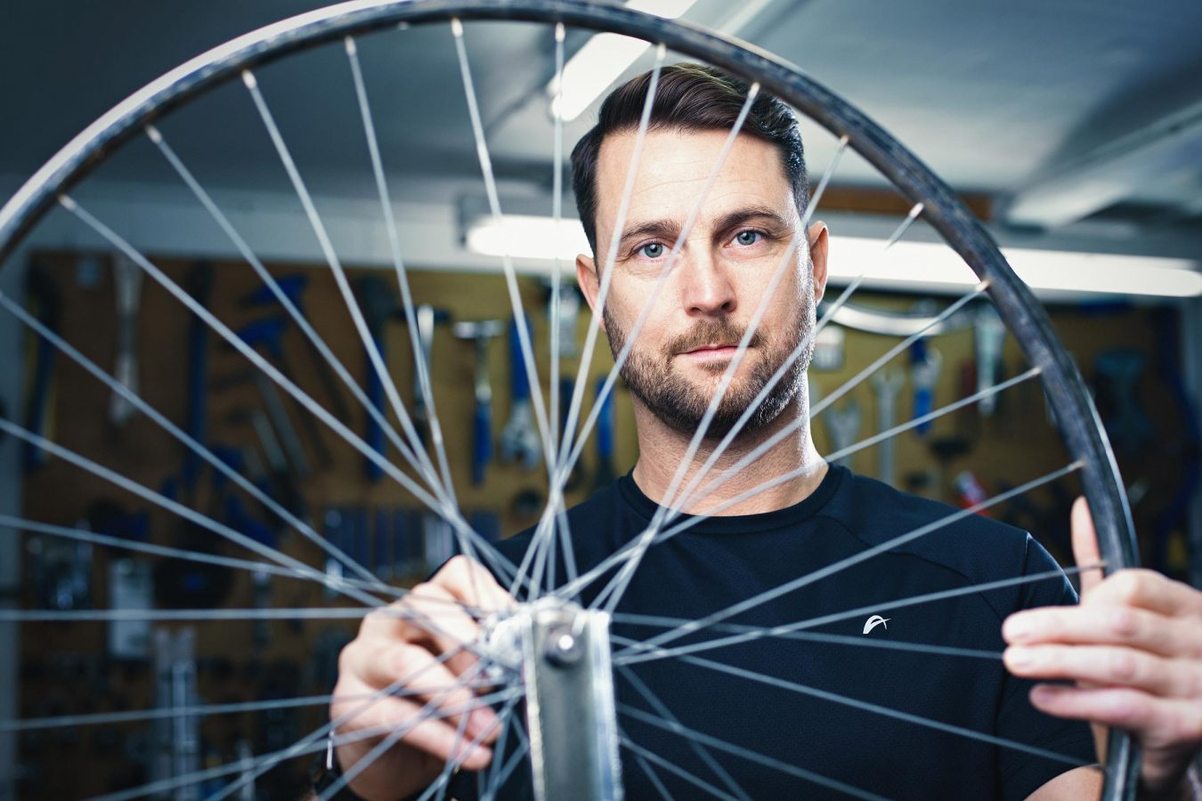 portrait-advertising-photography-bikeshop-man-cambridge