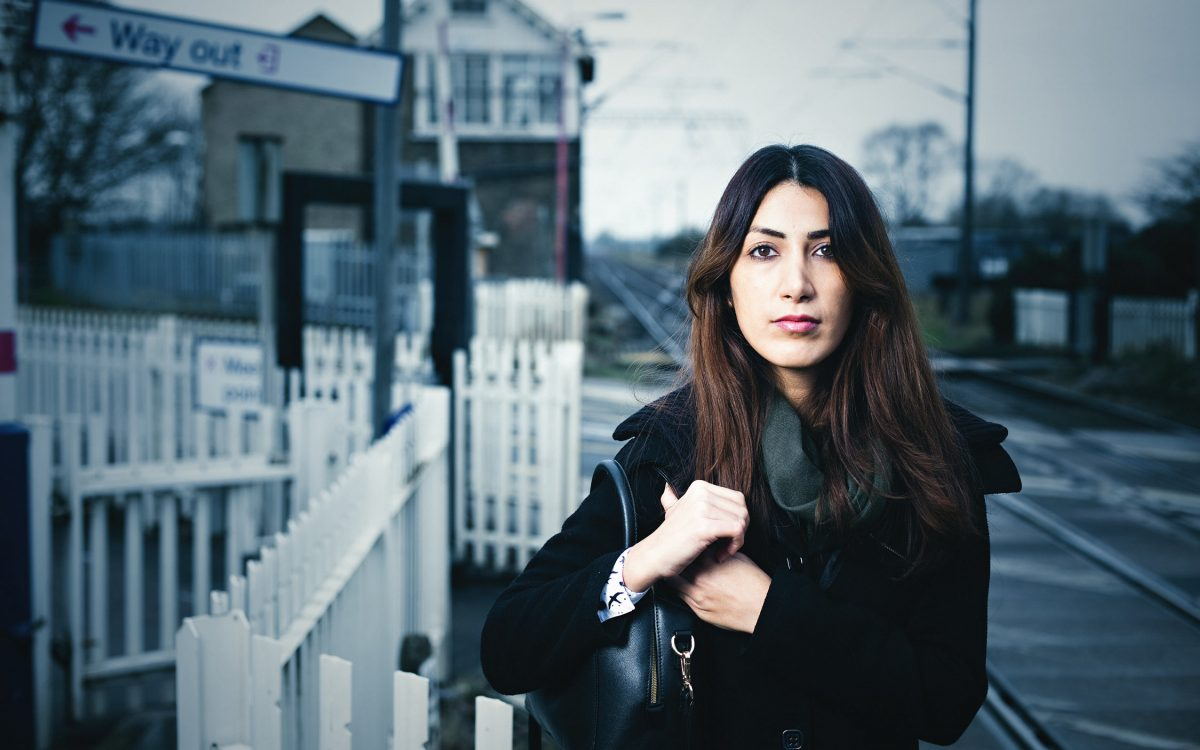 Stylish and moody advertising portrait of young woman at Foxton train station.