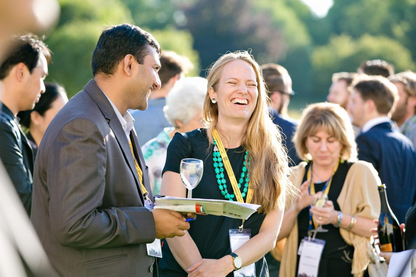 university-of-cambridge-conference-laughing-man-woman-delegates