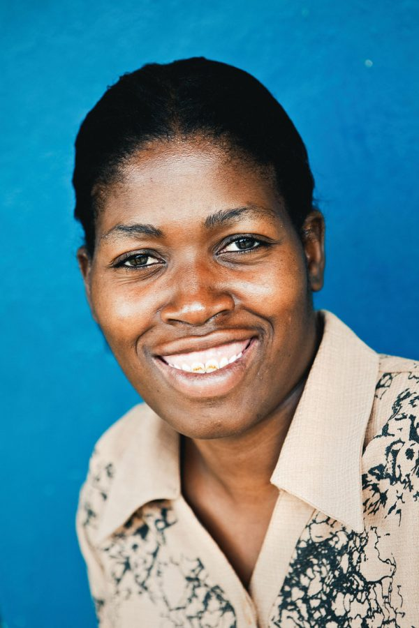 colourful-headshot-portrait-photography-malawi-happy-woman-blue