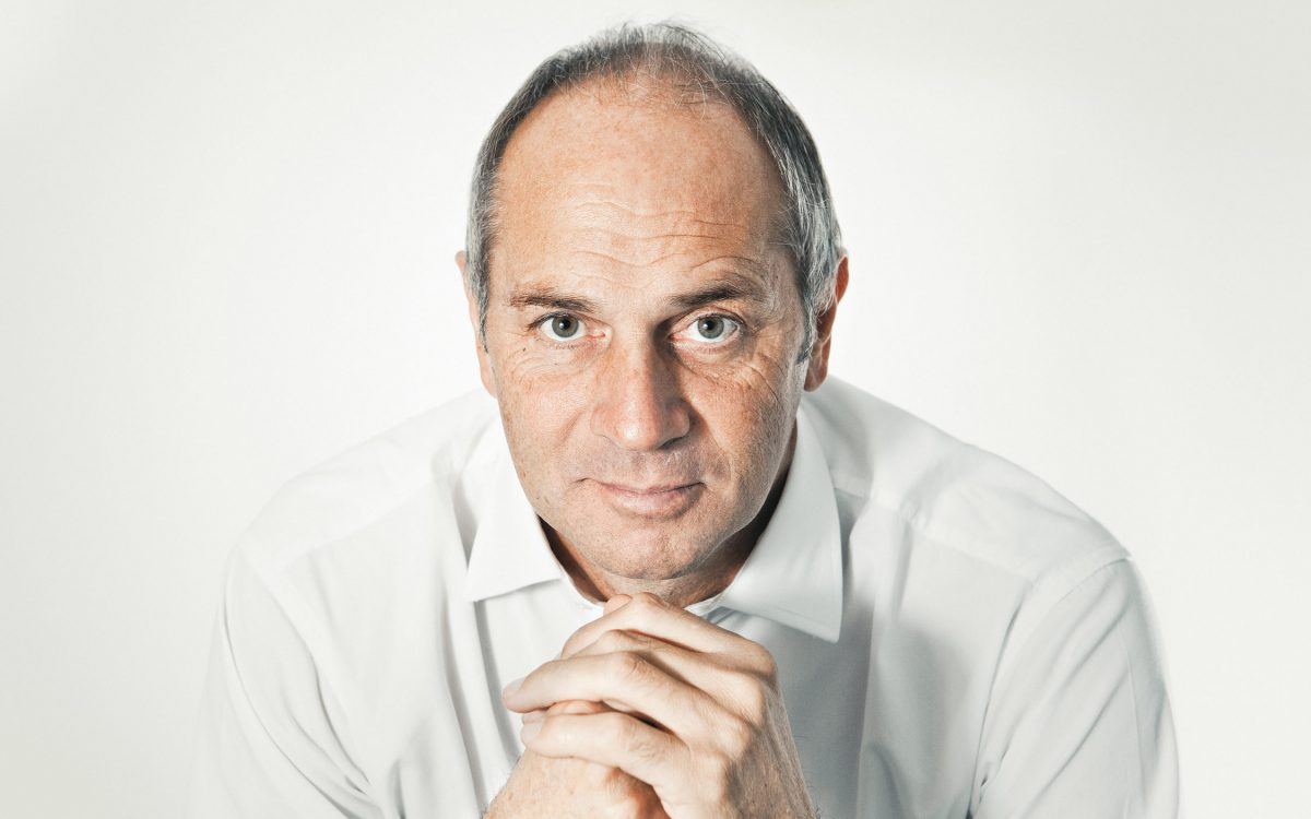 Studio photography portrait of Sir Steve Redgrave with an intense stare.