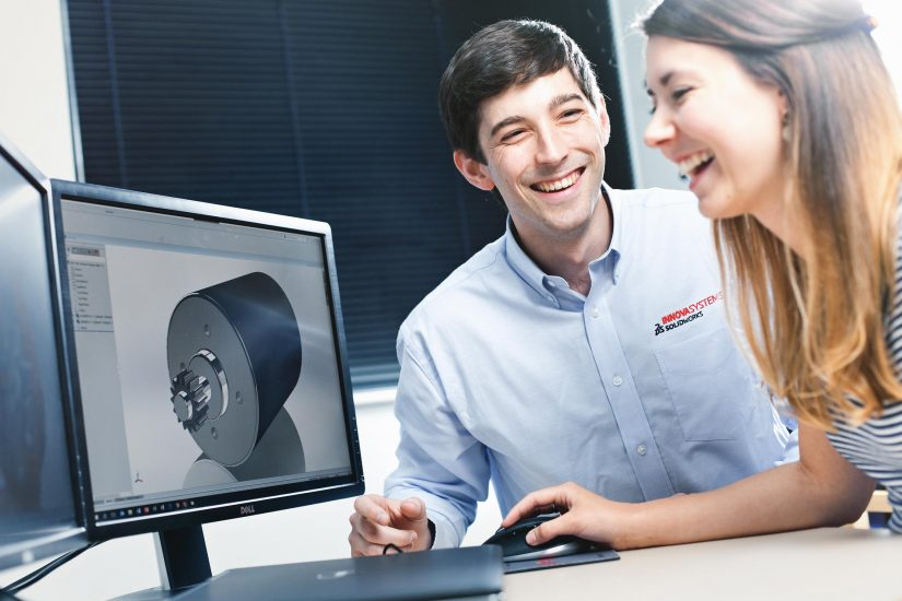 PR website photography of man and woman working together in a design office.