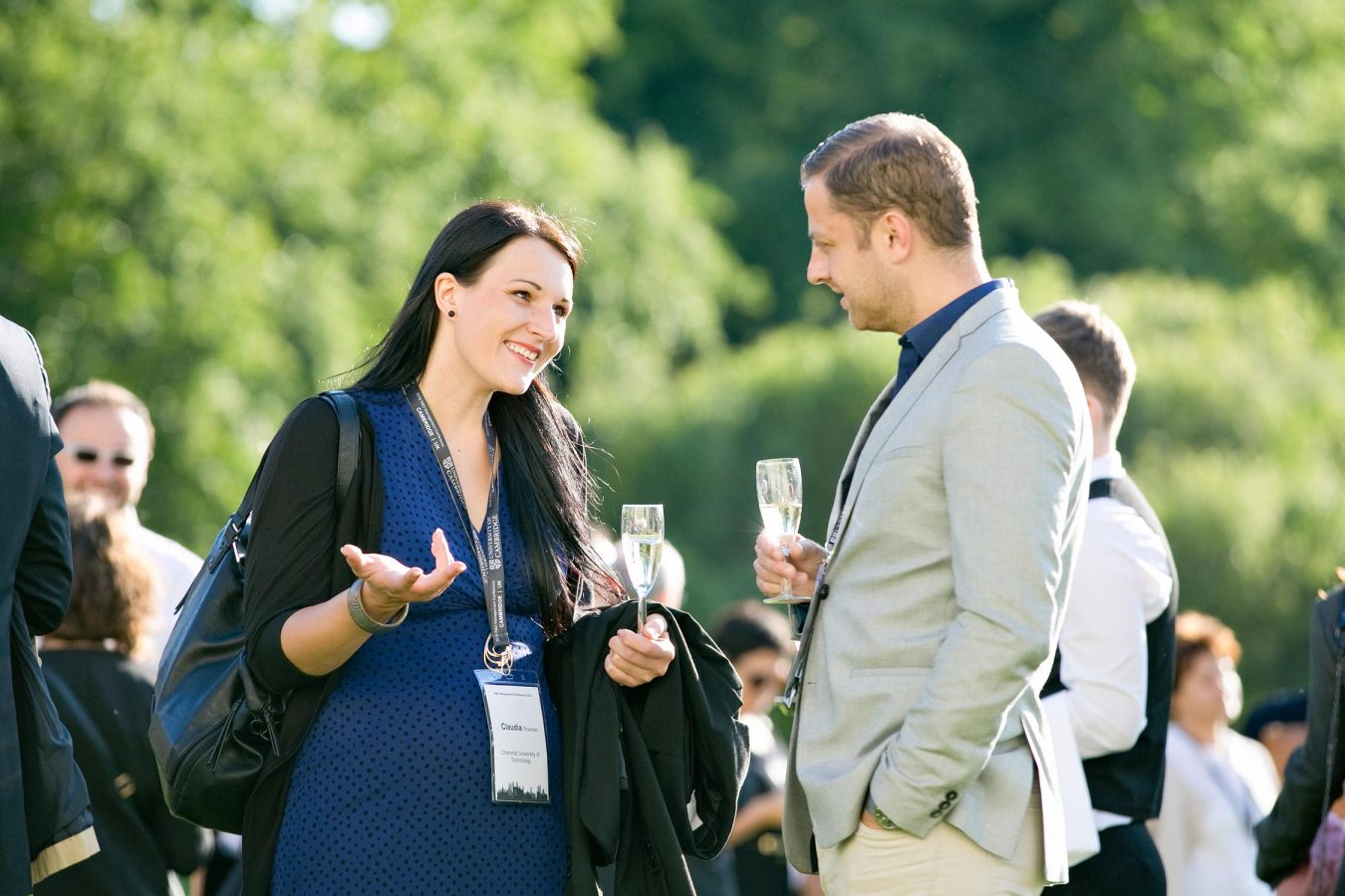 university-of-cambridge-conference-delegates-chatting-man-woman